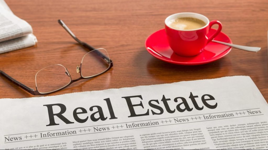 A newspaper on a wooden desk – Real Estate
